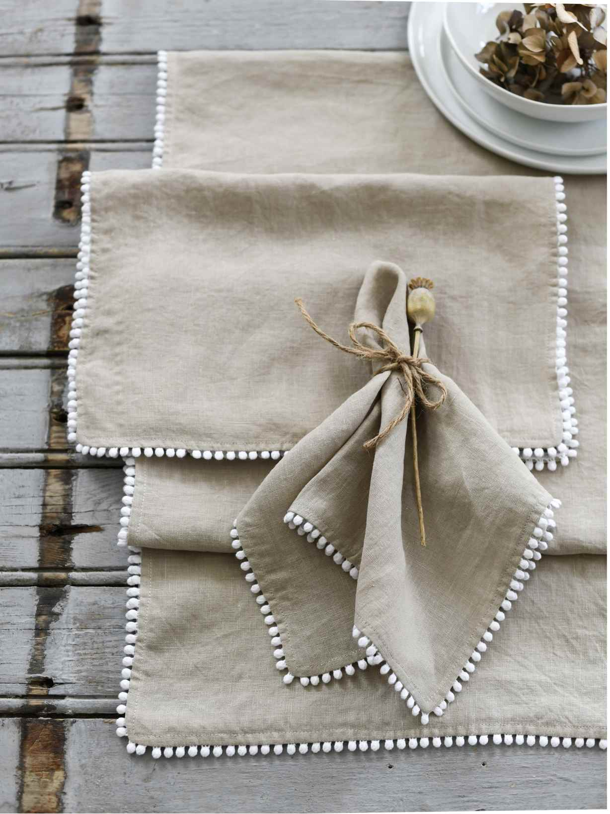 Nordic House Natural Pom Pom Table Linen